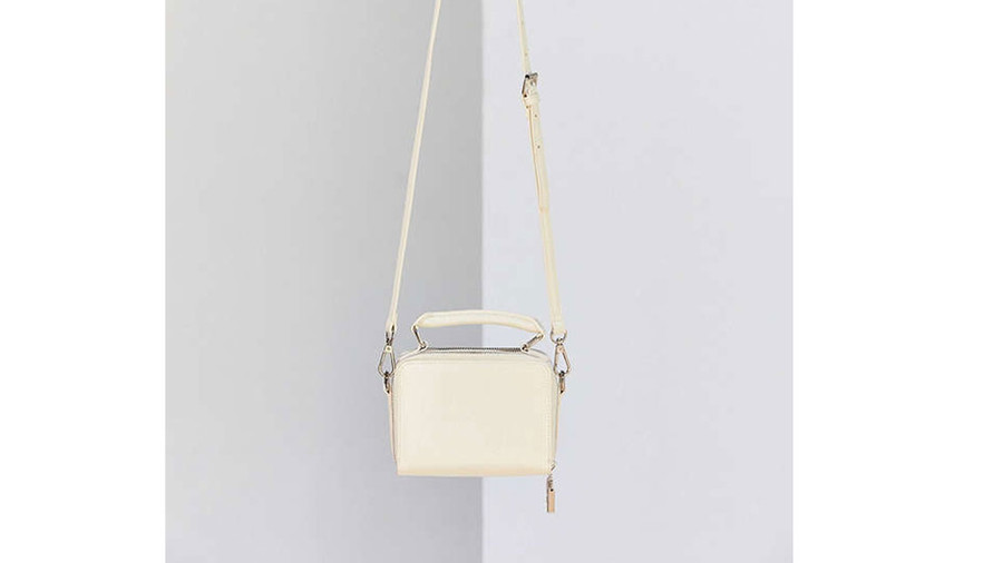 A simple box silhouette and top handle give this charmer ladylike appeal.