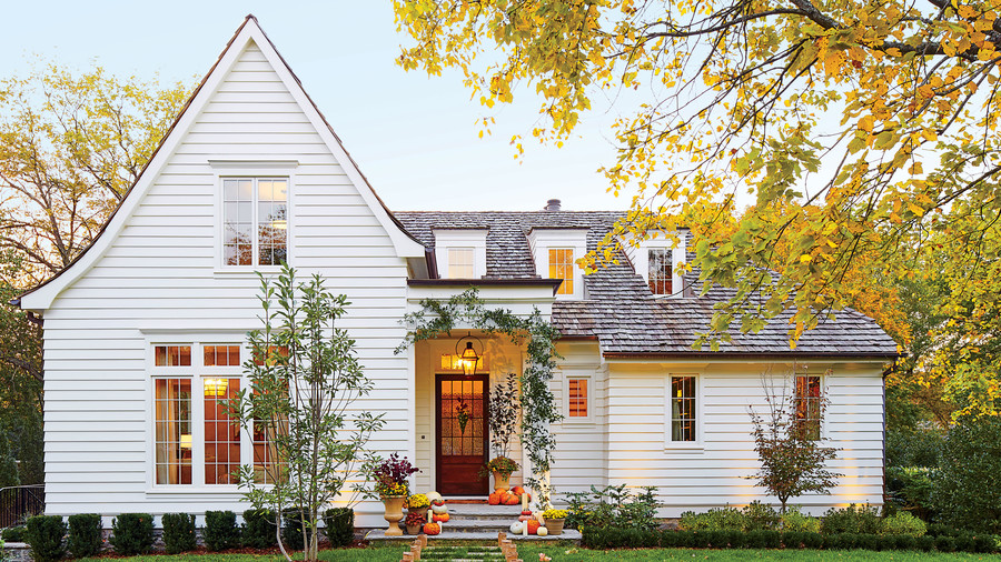White Exterior of Home Decorated for Fall