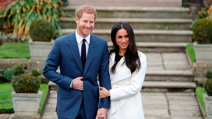 Meghan Markle Shows Off Engagement Ring in Wonderful White Coat