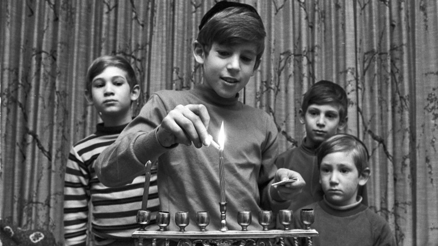 Kids Lighting Menorah