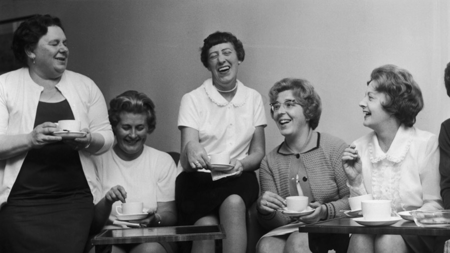 Group of Women Drinking Tea and Laughing
