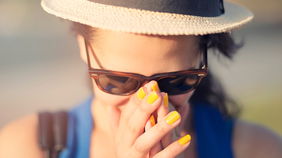 Woman with Yellow Nail Polish