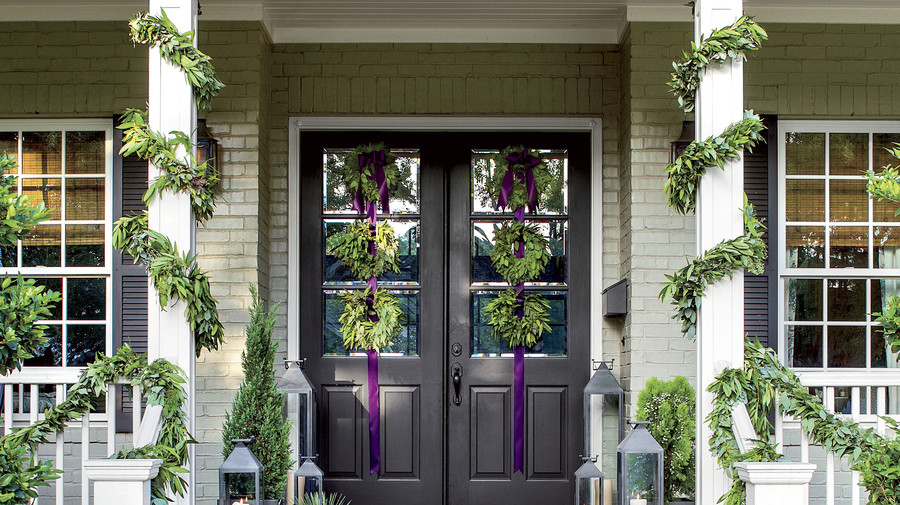 Front Door with 6 wreaths and garland wrapped porch posts