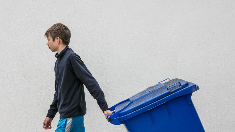 Boy Taking Out/Bringing in Trash Can
