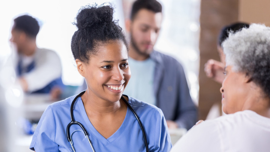 Woman with Young Nurse/Doctor