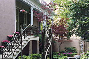 Savannah courtyard garden with walkway and statuary
