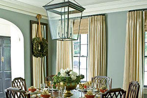 pale, steel gray walls in the dining room with floor to ceiling cream shades (and a round dining room table and chairs)