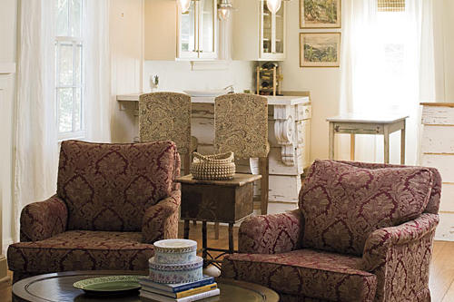 kitchen barstools with light tan, ornate, stitched fabric