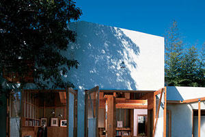 white, stylish garage remodeled into guest quarters