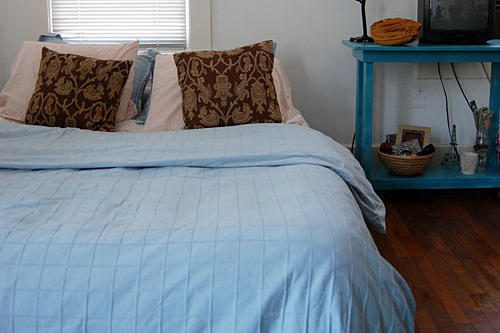 before photo of a bedroom with a pale blue duvet cover