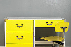 bright yellow desk and roller chair