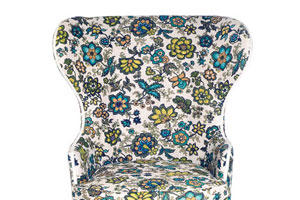 flowered wing chair with a curved top part