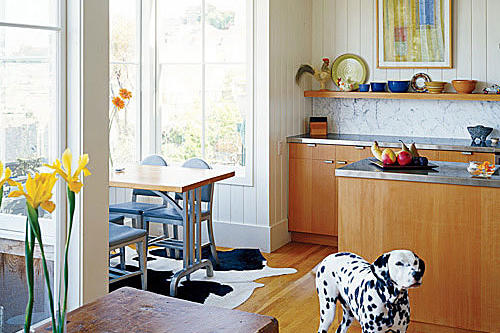 light breakfast bay space to the left of the renovated, contemporary kitchen