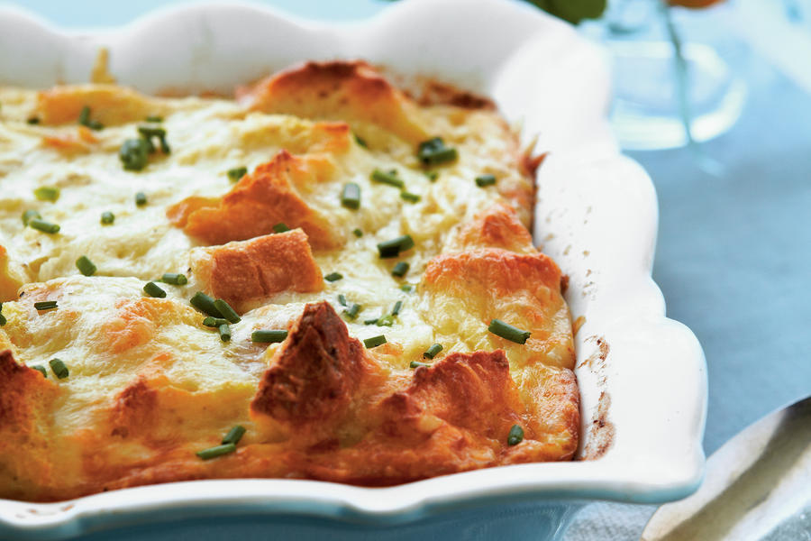Made with Swiss and Parmesan cheese atop a base of french bread cubes, this creamy egg dish is worth waking for.