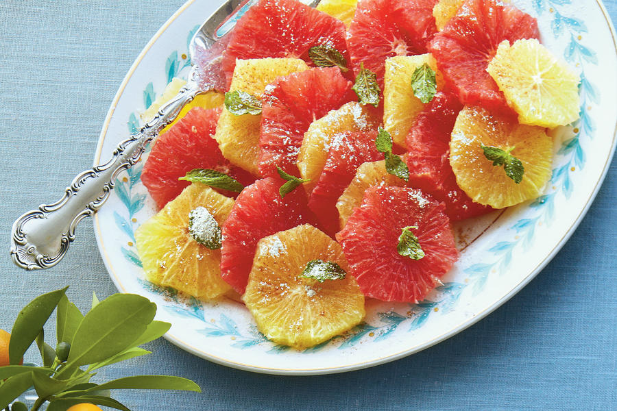 A citrus plate is a bright, cheerful addition to any party. If you don't have time to section your own citrus, purchase a few refrigerated jars from the produce aisle.