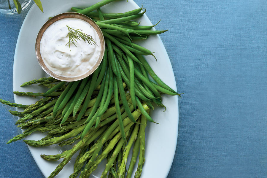 Showcase the first signs of springs with tender spears of asparagus and haricots verts serving as crudites for this creamy fresh herb dip.