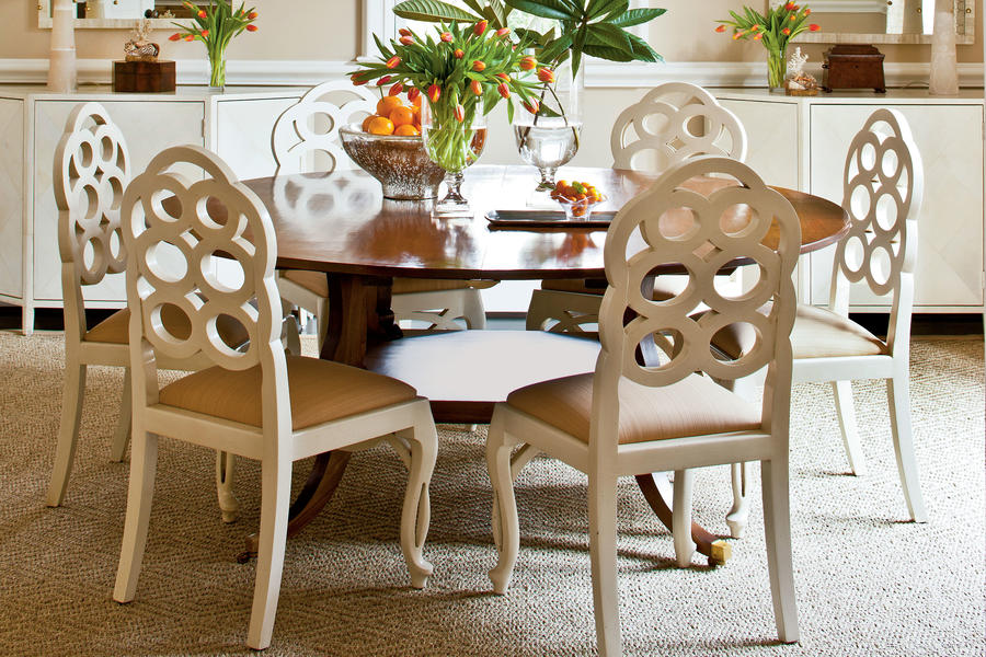 A large round table in a square dining room makes conversations easier and most have leaves for extra seating.