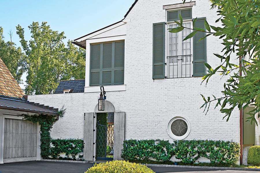 Home Exterior with White Brick and Green Shutters