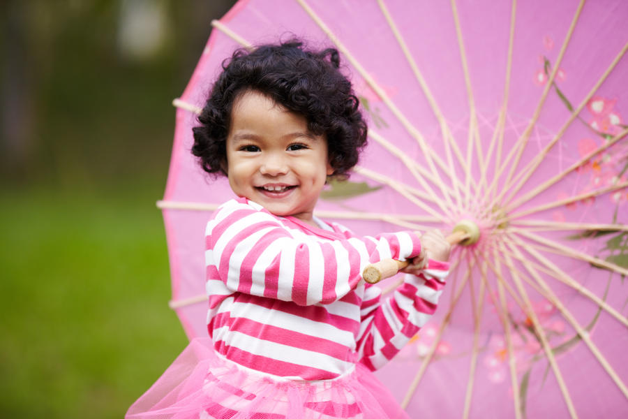 girl playing with a paper umbrella