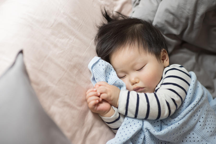Baby in stripe shirt sleeping