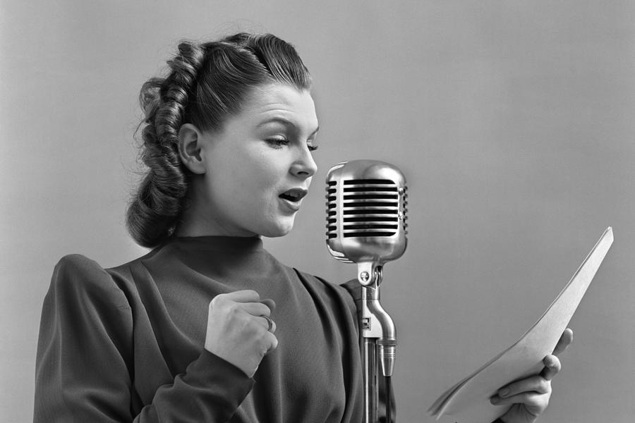 1940s woman speaking into microphone
