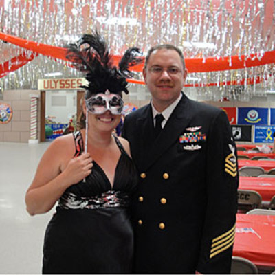 my handsome husband and i at a mardi gras ball honoring the military