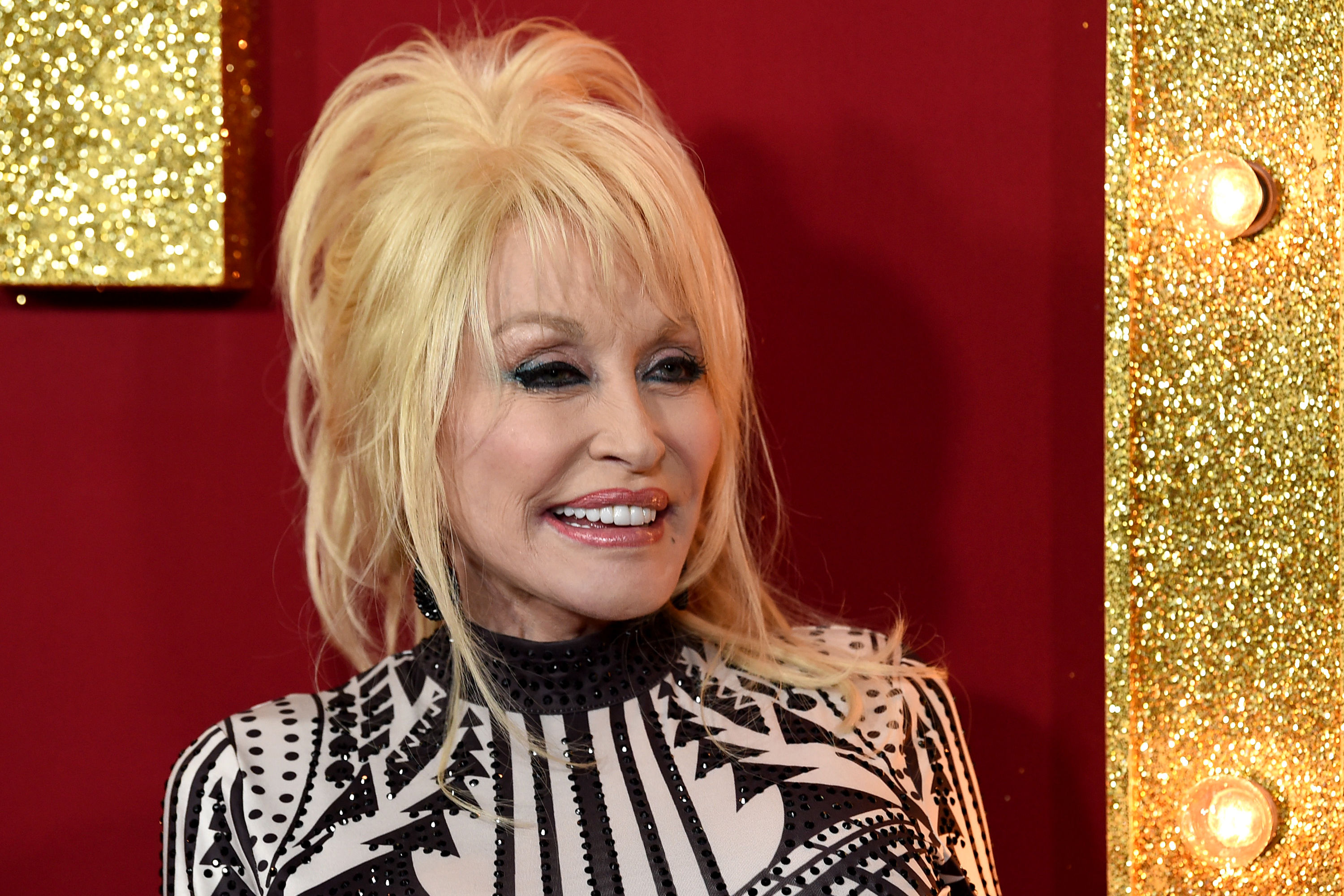 The Real Reason Dolly Parton Has Tattoos