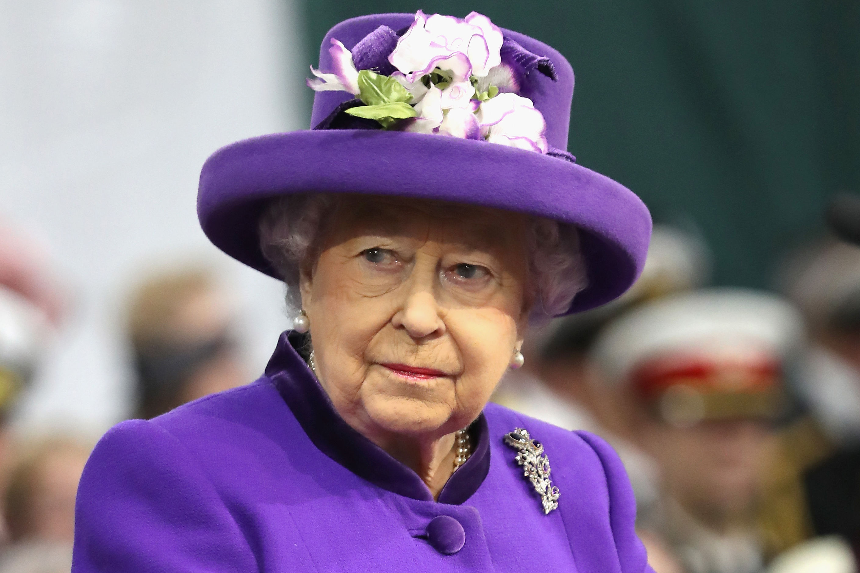 This Is How the Queen Uses Her Jewelry To Send Her Staff Secret Signals