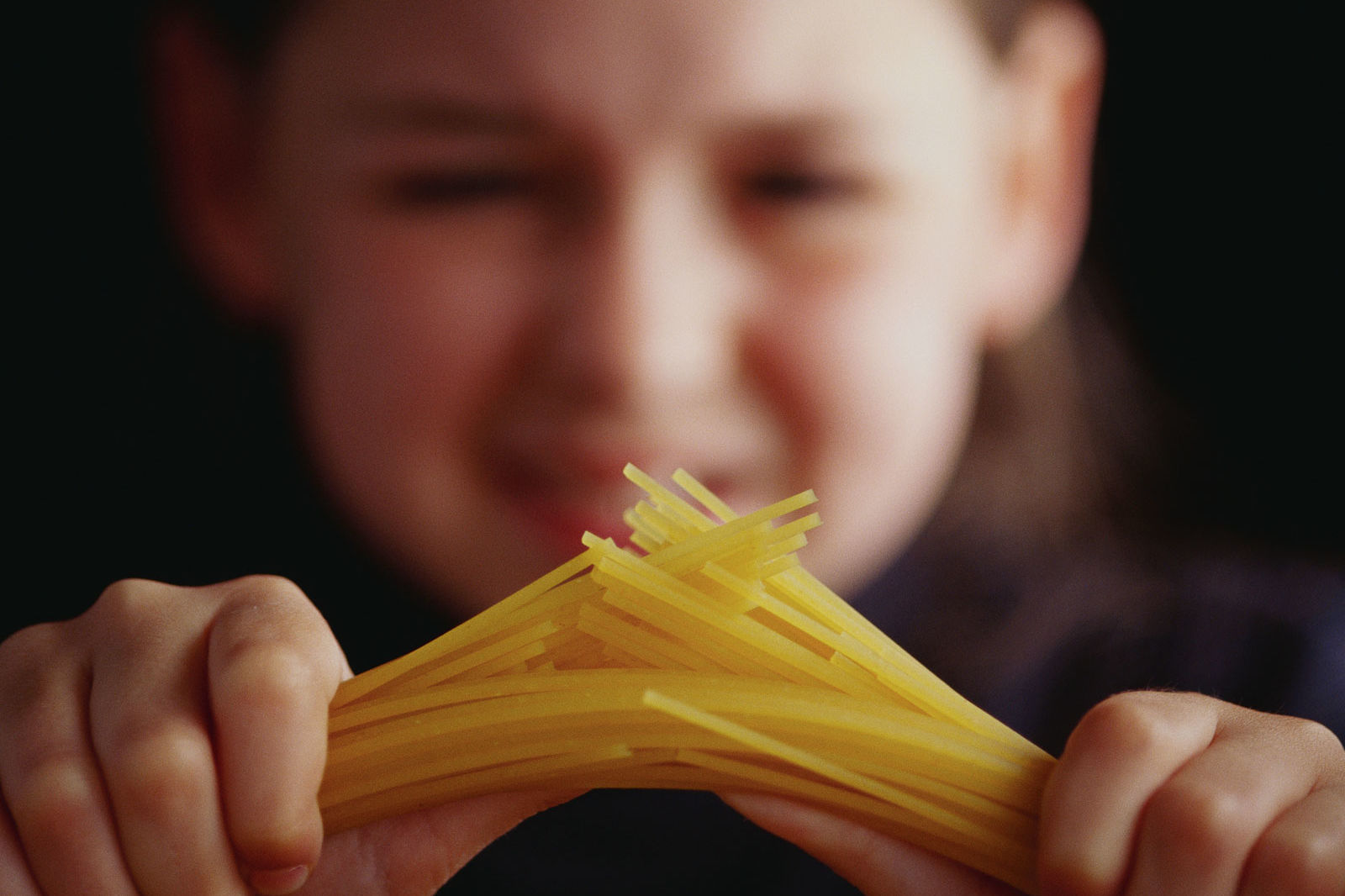 Science Has Found a Way to Snap Dry Spaghetti into Two Equal Pieces