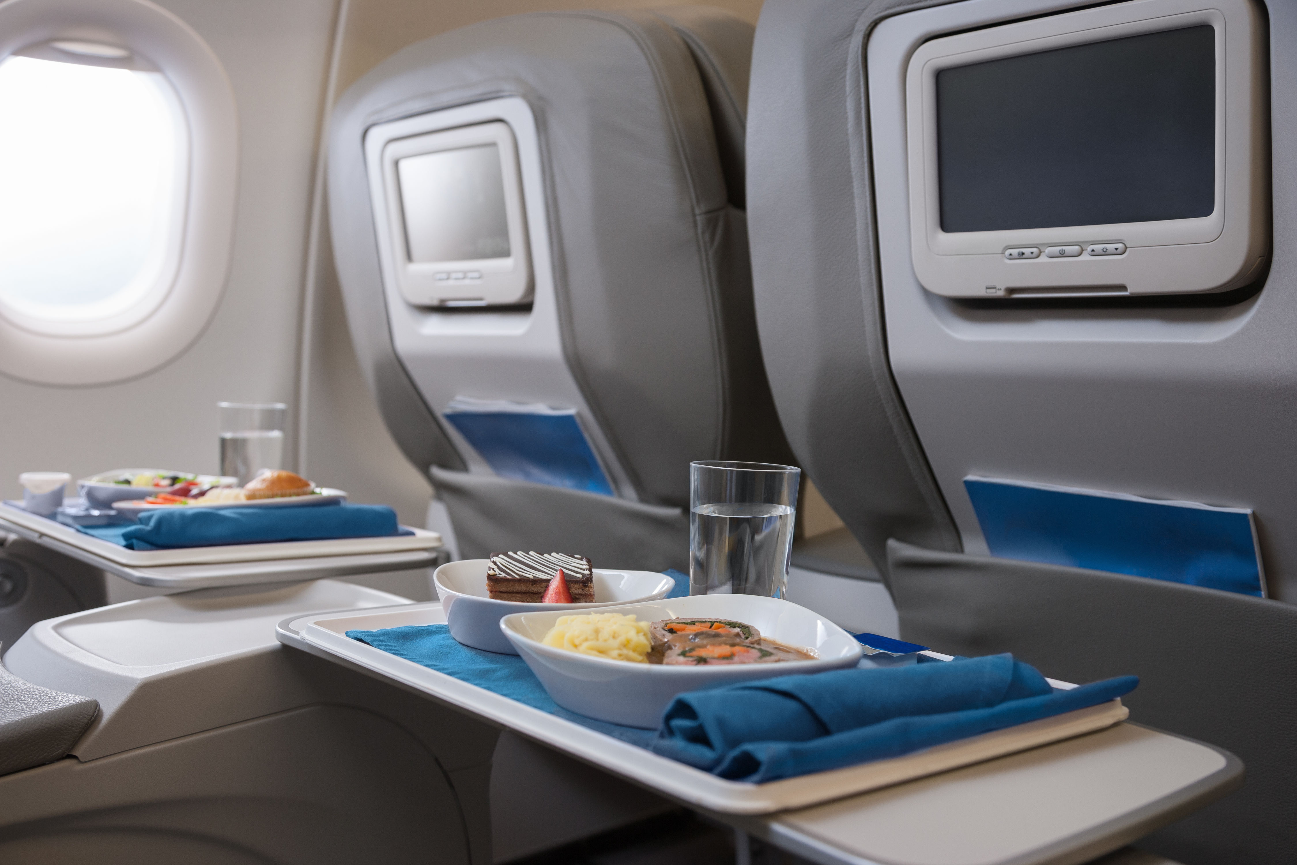 Why You Should Never Eat Food on Planes, According to the Experts