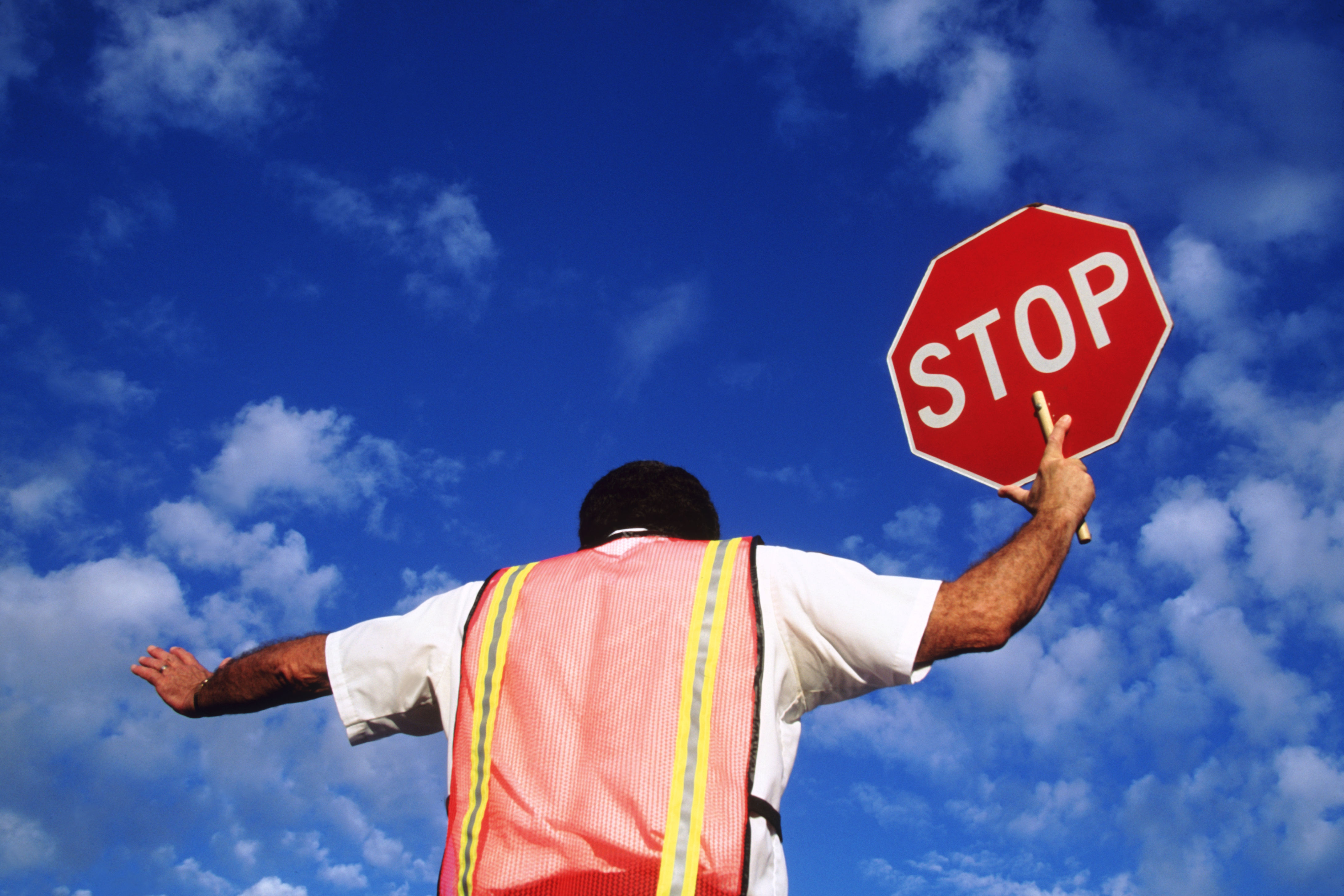 Beloved Volunteer Crossing Guard of 19 Years Does So Much More Than Keep Kids Safe