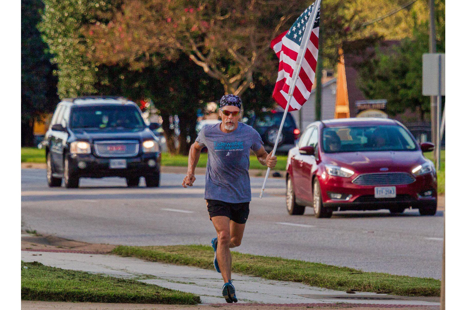 Virginia Man Runs with American Flag in Hand to Honor Those Deployed—His Son Included