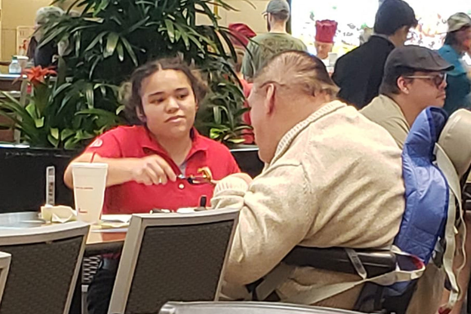 Chick fil-A Employee Spotted Feeding Disabled Customer in Texas Food Court