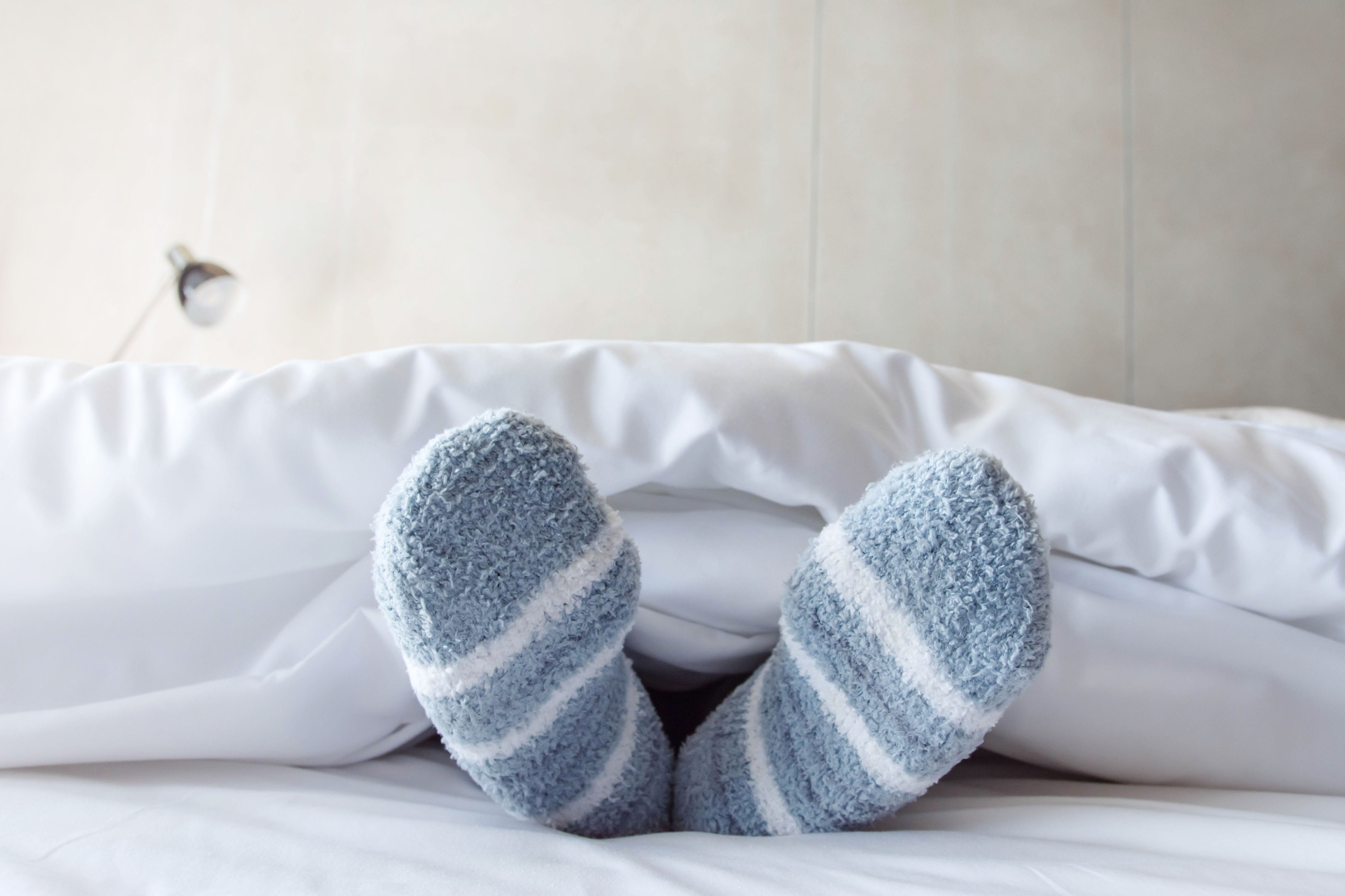 The Truth About Why Some People Love Sleeping with Socks on and Others Hate It