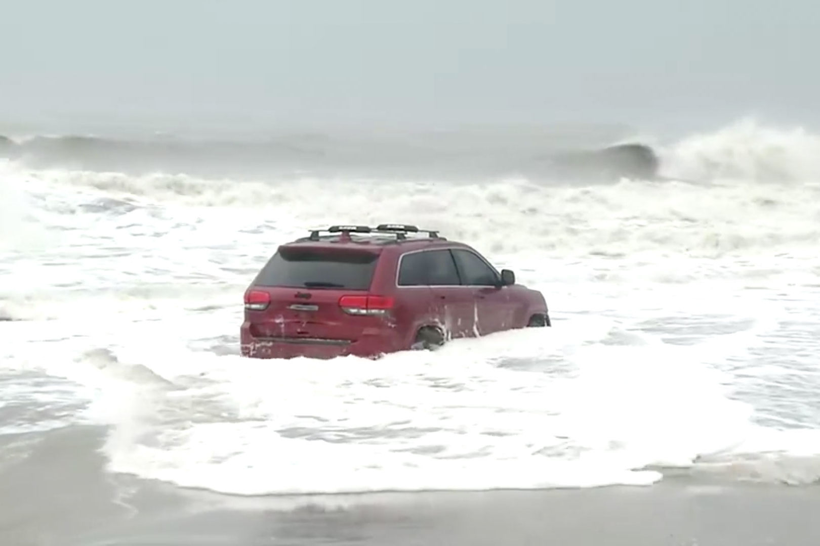 We Can't Get Enough of the Mysterious Red Jeep Left on Myrtle Beach During Hurricane Dorian