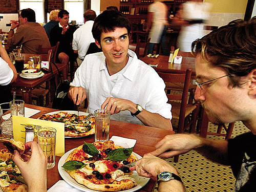 people dining on pizza at 2 amys