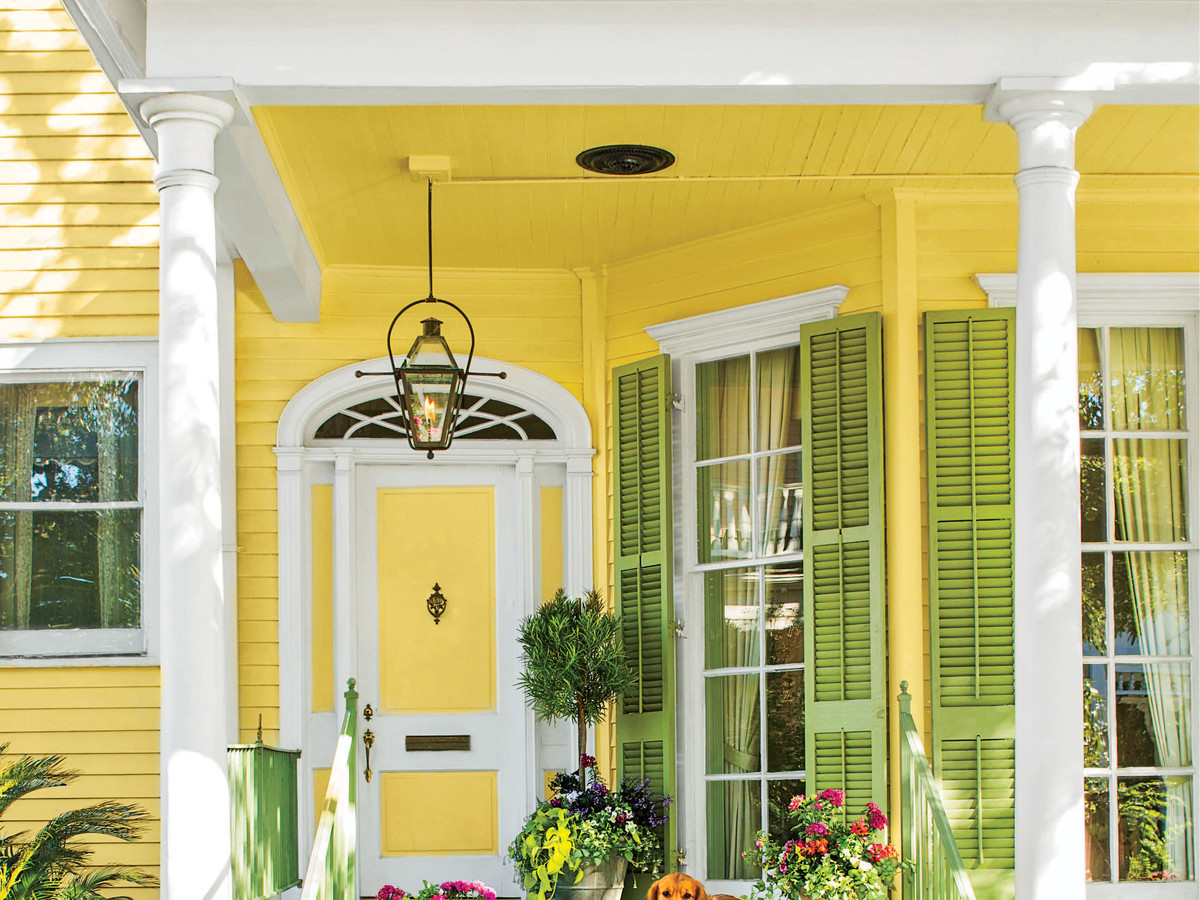 Yellow House Exterior Green Shutters with Dog