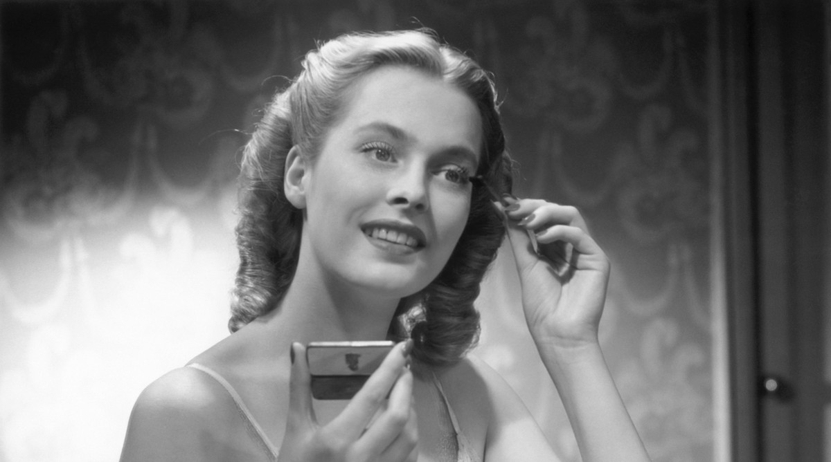 Vintage Woman Putting On Mascara