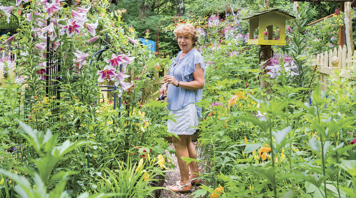 Mary Startzman in her Berea, Kentucky Garden with Lilies Blooming