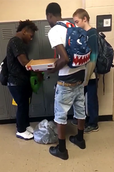 Memphis Football Players Give Their Clothes to Classmate Bullied for Wearing Same Outfit Every Day