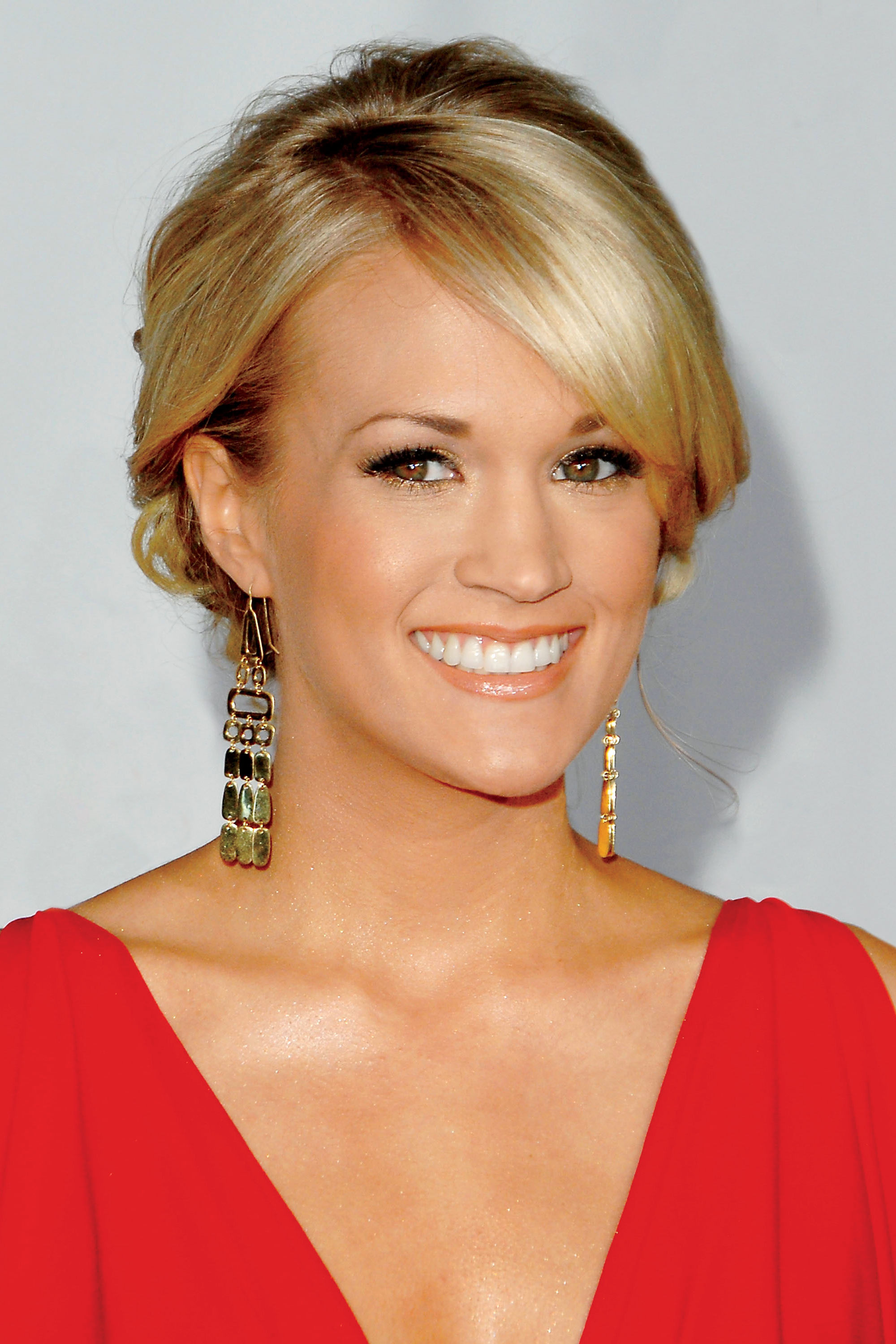 Carrie Underwood's Holiday Plans Include a Lot of Traveling and a Little Decorating: 'You Have to Have a Tree!'