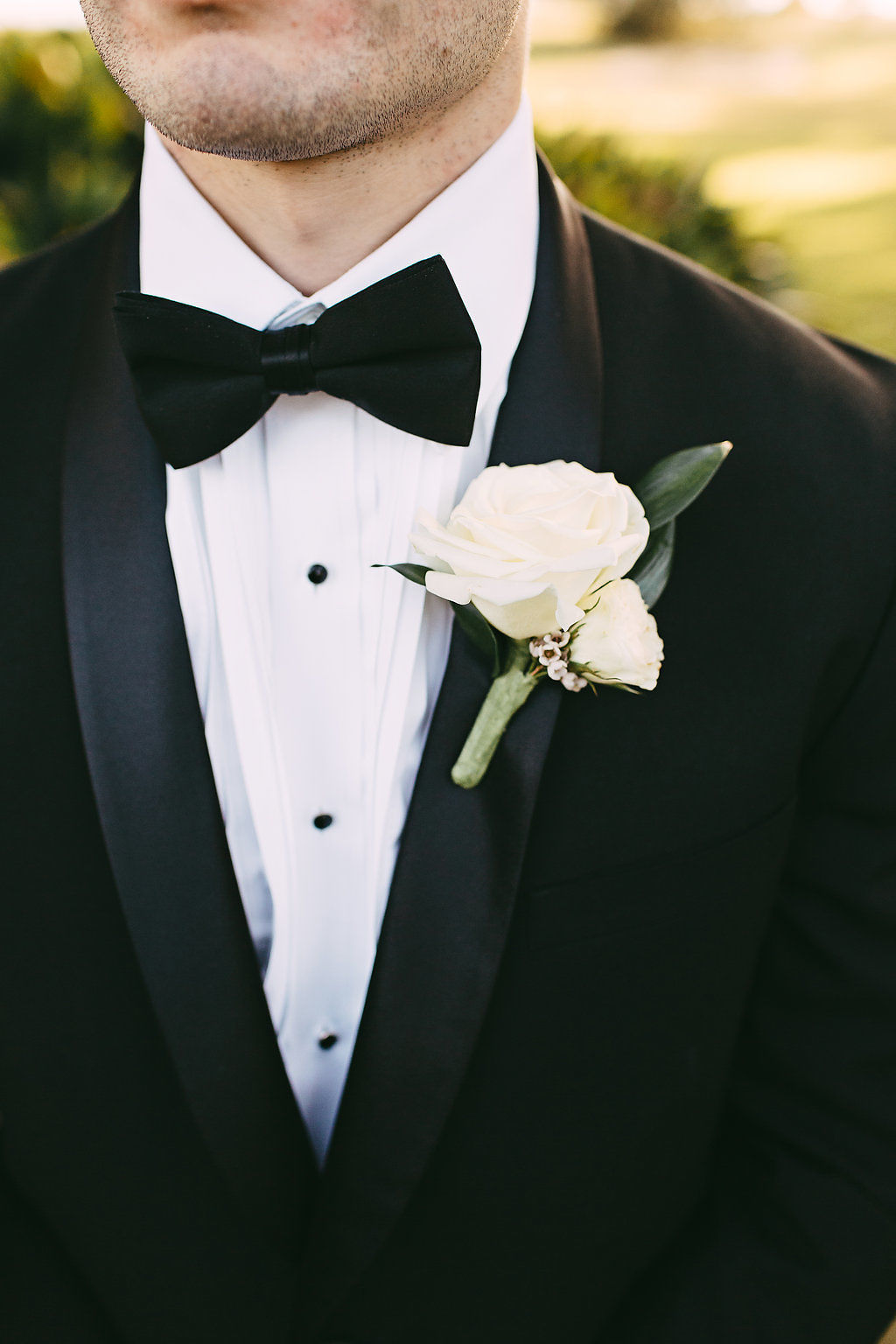 The Proper Way To Put On a Boutonniere