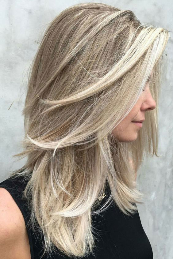 Medium Length Hairstyles Were Loving Right Now Southern Living