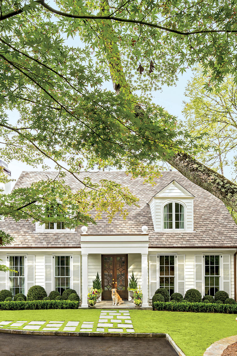 Charming home exteriors southern living for Pictures of pretty houses