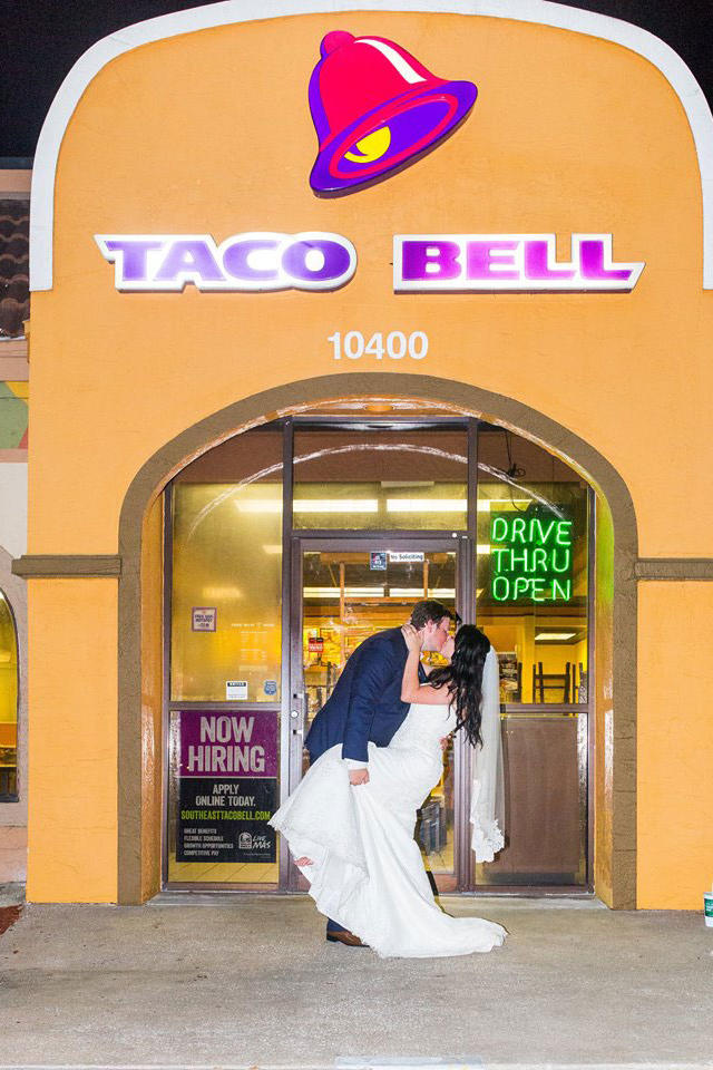 Couple Kissing in Front of Taco Bell Wedding Photo Shoot