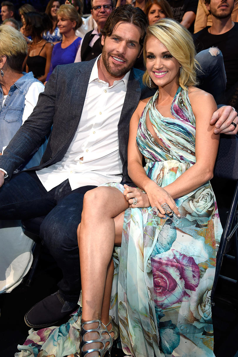 Carrie Underwood and Mike Fisher Sitting and Smiling