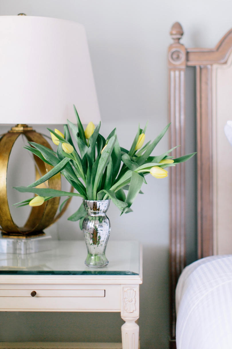 Fresh tulips on a nightstand