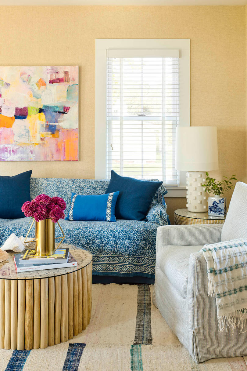 "She applied this same come-as-you-are decorating ethos to the family room. ""It's the kind of place where people will leave a sweating glass of iced tea on the coffee table and put their feet up, so we wanted to keep things simple and straightforward,"" say"