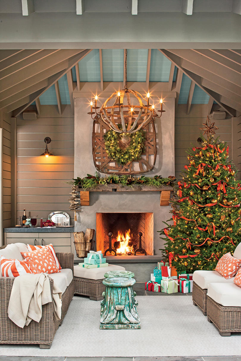 set a holiday scene in your outdoor room - Unique Christmas Decorating Ideas