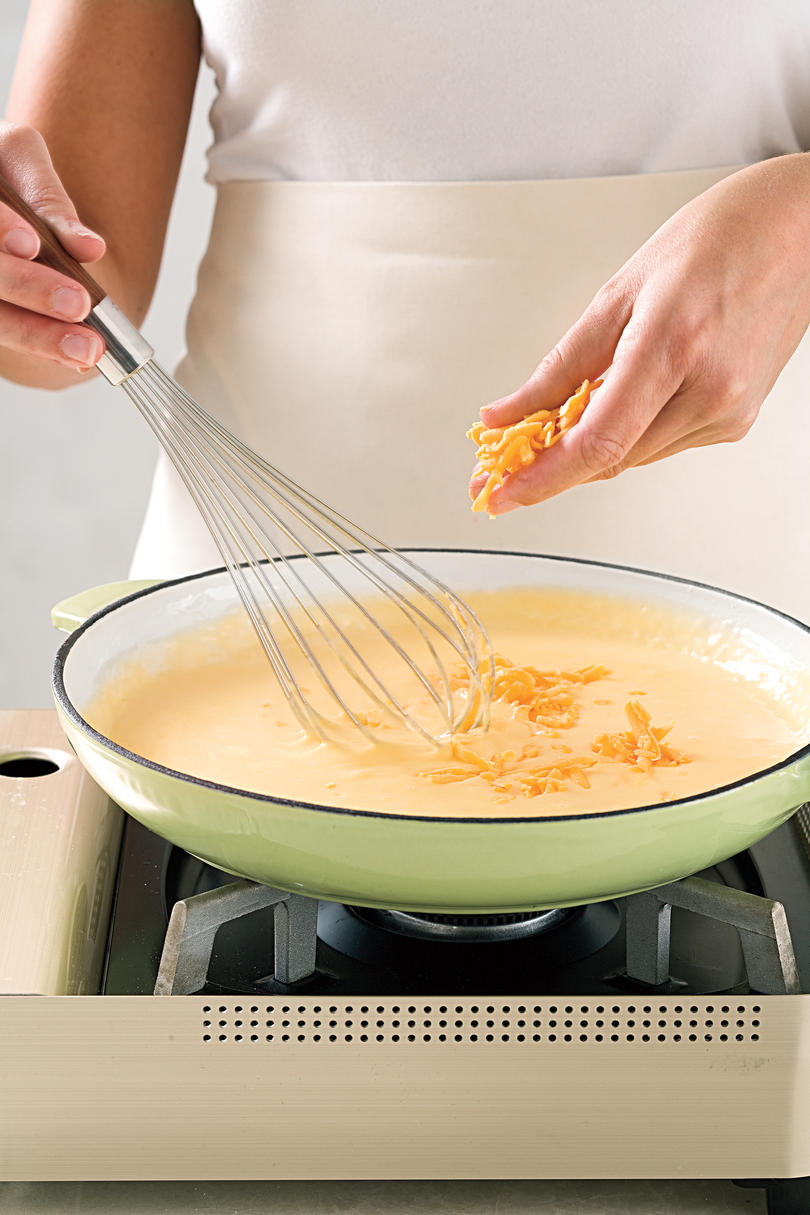3. Whisk In Cheese